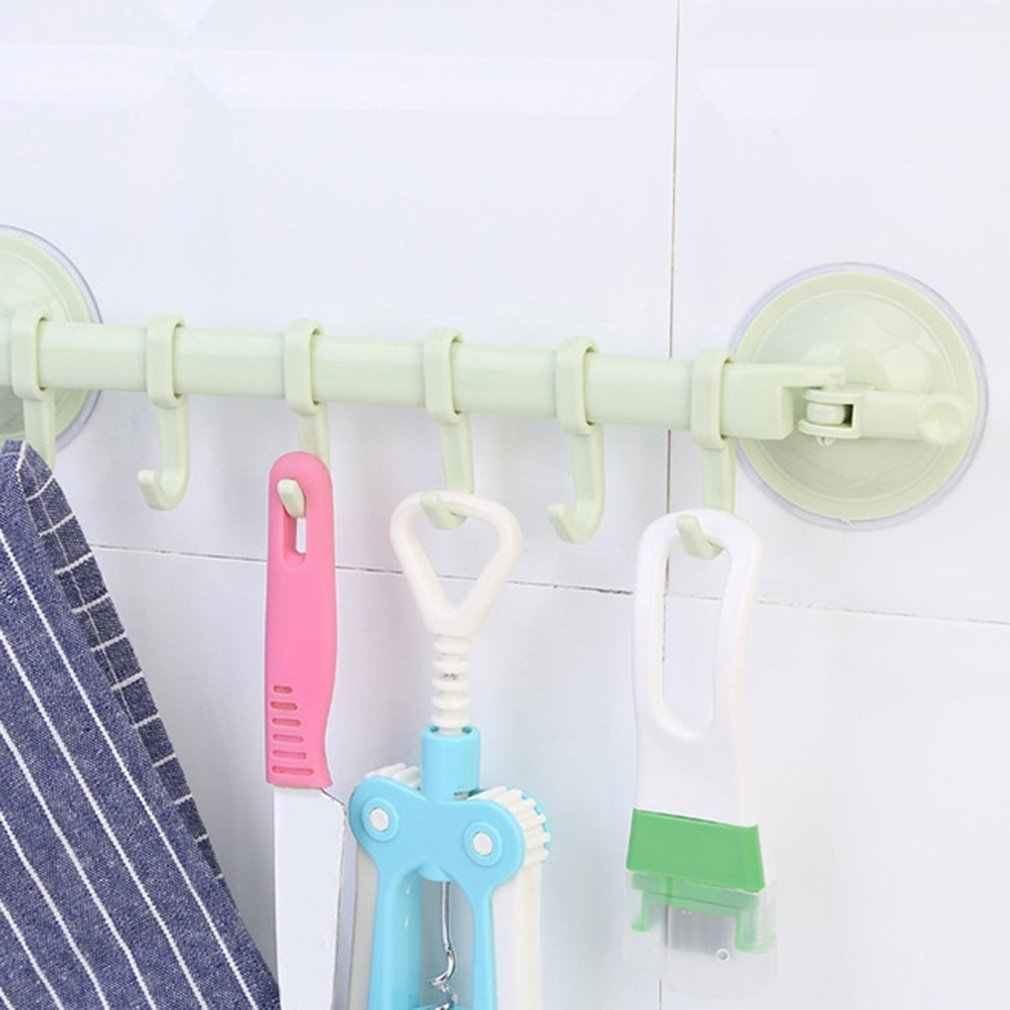 Přenosný držák s háčky - zelený