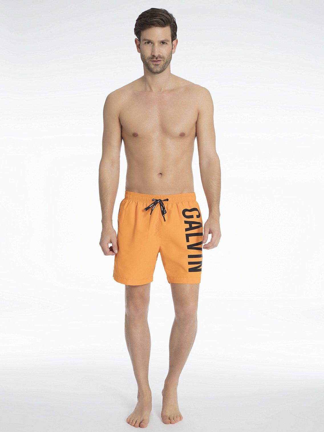 Pánské plavky KM0KM00150-803 oranžová - Calvin Klein - Oranžová/XL
