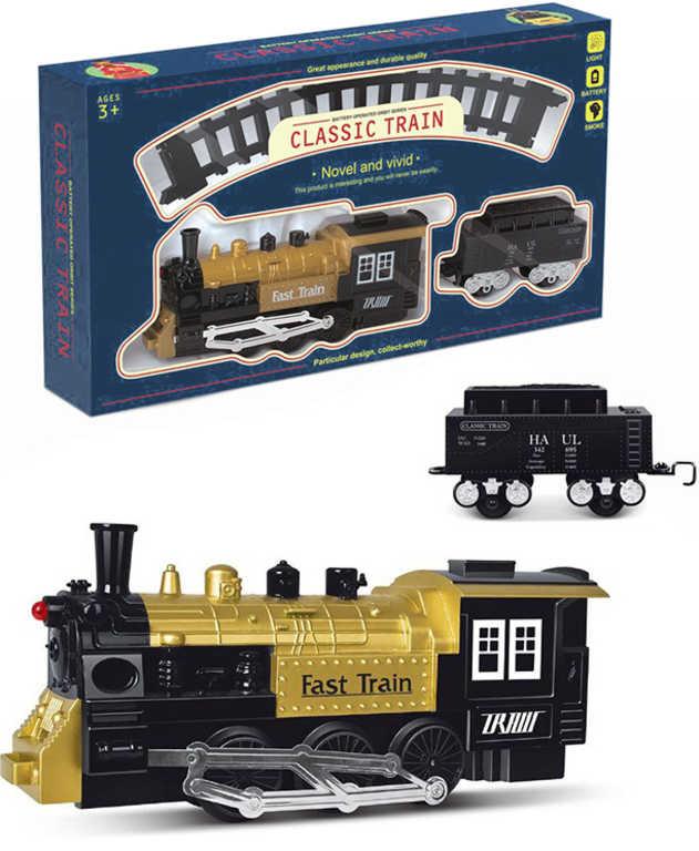 Vlak kouřící parní lokomotiva 23cm set s kolejemi a vagónem na baterie