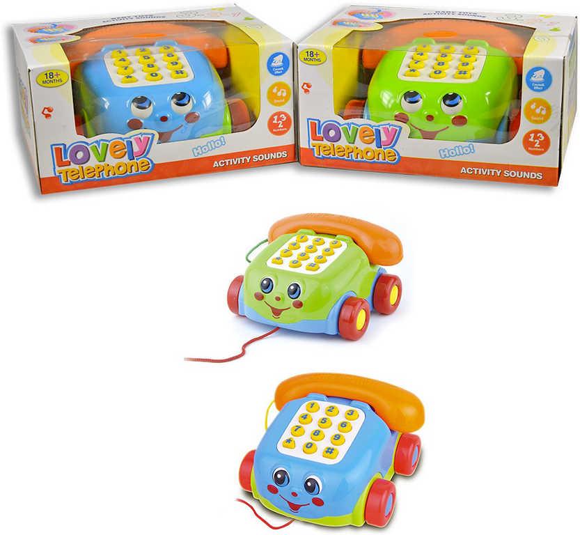 Baby telefon s obličejem tahací na baterie na kolečkách - 2 barvy