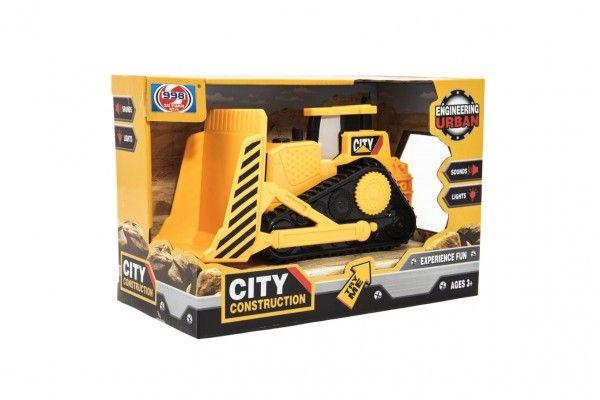 Stavební stroj buldozer plast 20cm na setrvačník na bat. se světlem se zvukem v krabičce 21x14x11cm